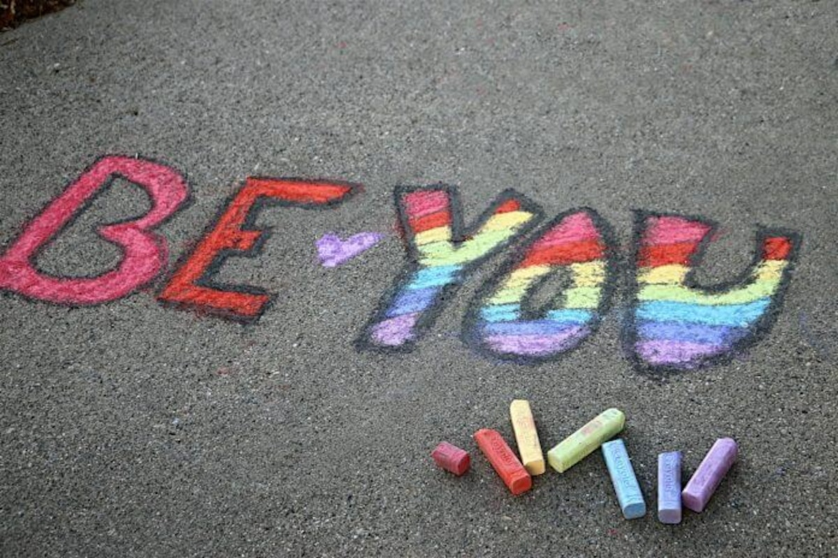 conceptual-message-written-on-a-sidewalk-with-colorful-chalk_t20_noKJ9K-696x464