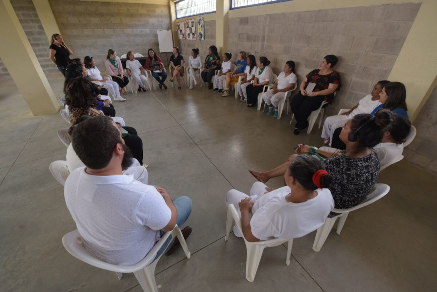 Rep. Raquel Teran (seated against the wall, dressed in black and red) listening to 13 women imprisoned in El Salvador, where abortion is completely criminalized. Photo via Menly Cortez for State Innovation Exchange