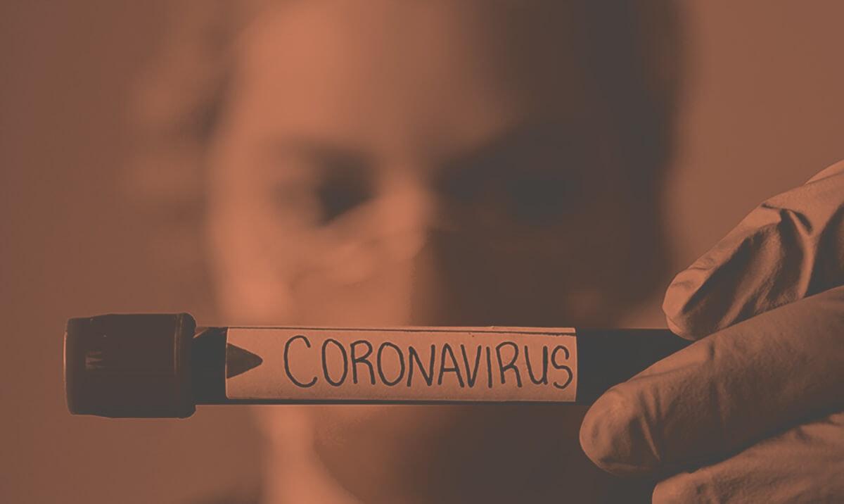 Blood vial with word coronavirus written on it