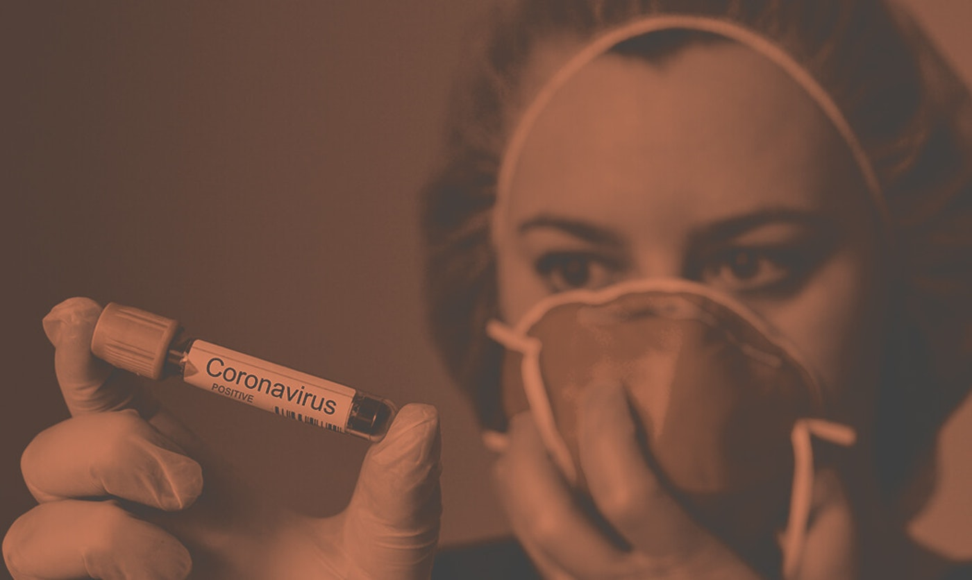 nurse holding coronavirus test