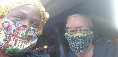 Buffy Riley, right, and one of the nurses she works with treating patients hospitalized with COVID-19 at Woodhull Medical and Mental Health Center in New York wear masks made by Eau Claire resident Deb Peterson and sent to Riley. Nurses at many New York hospitals said they lack enough masks and other personal protective equipment. (Photo by Buffy Riley)