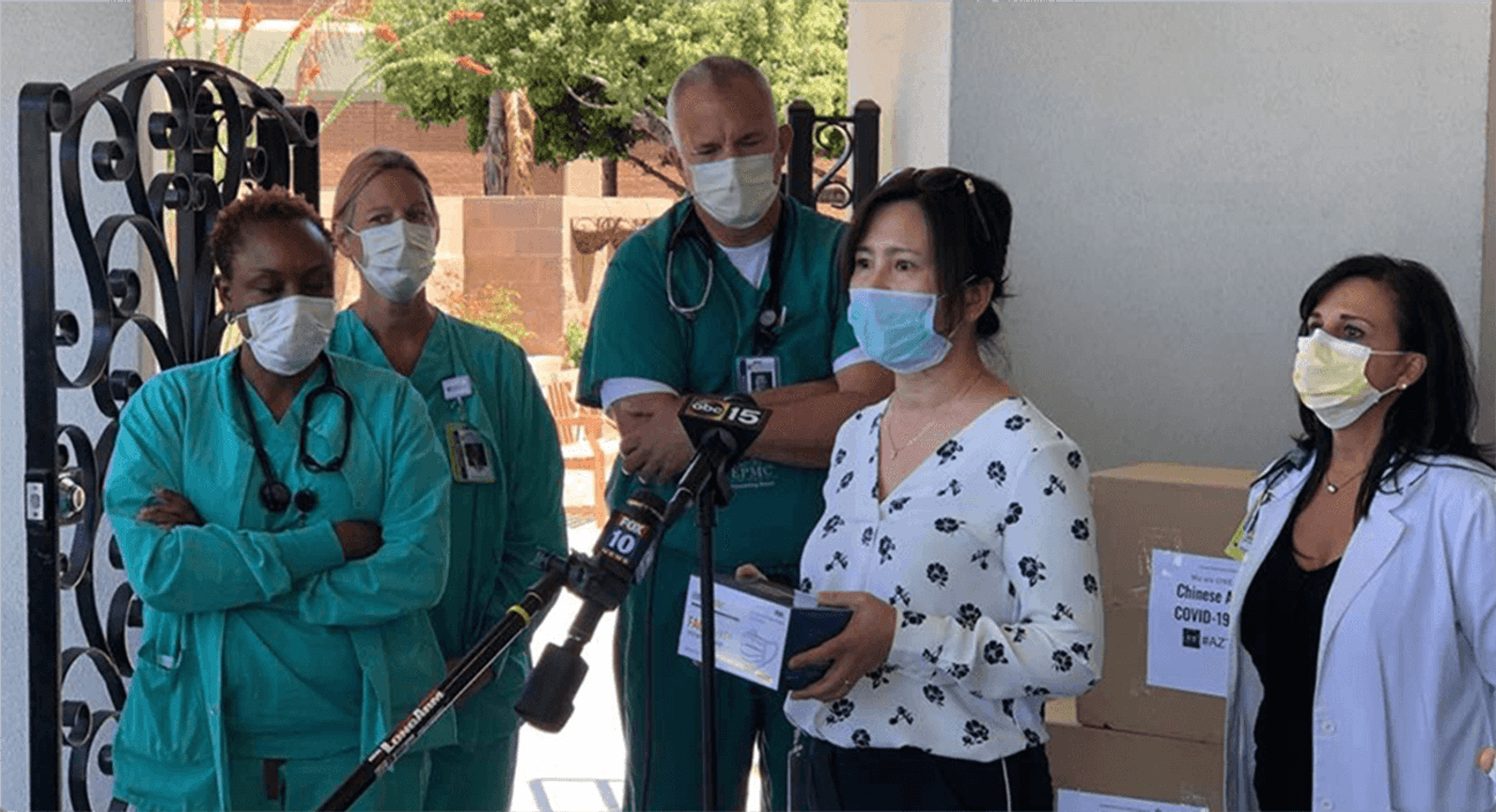 member of Chinese American coronavirus recovery group donates medical masks