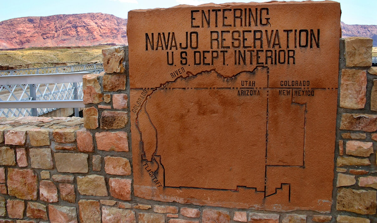 "sign saying ""entering Navajo reservation"""