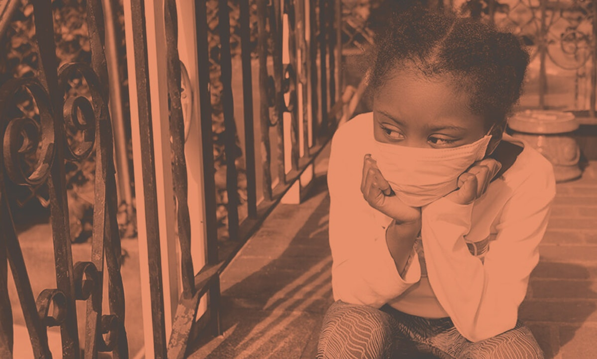 young girl wearing face mask looking sad on stoop