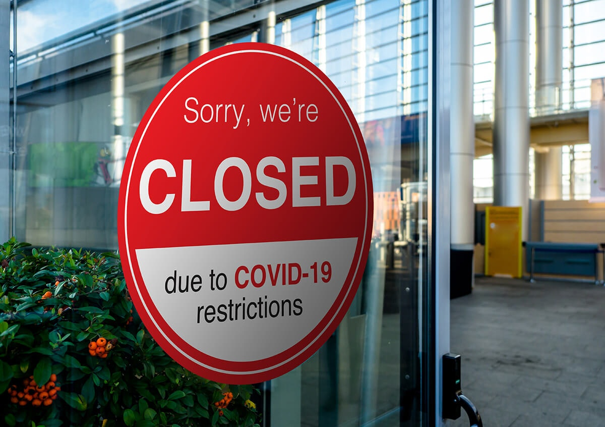 """sign that says """"sorry we are closed due to COVID-19 restrictions"""""""