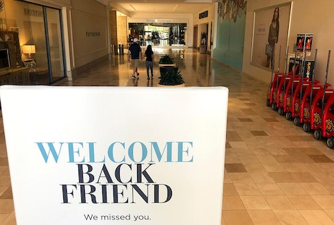 "sign saying ""welcome back friend"" in Chandler mall"