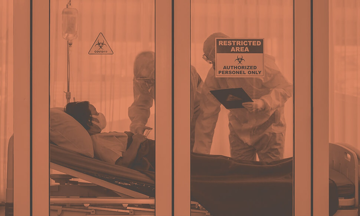 two doctors in protective suits visit quarantined patient