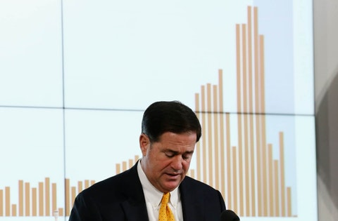 Arizona Republican Gov. Doug Ducey pauses as he speaks about the latest coronavirus data at a news conference Thursday, June 25, 2020, in Phoenix. (AP Photo/Ross D. Franklin, Pool)