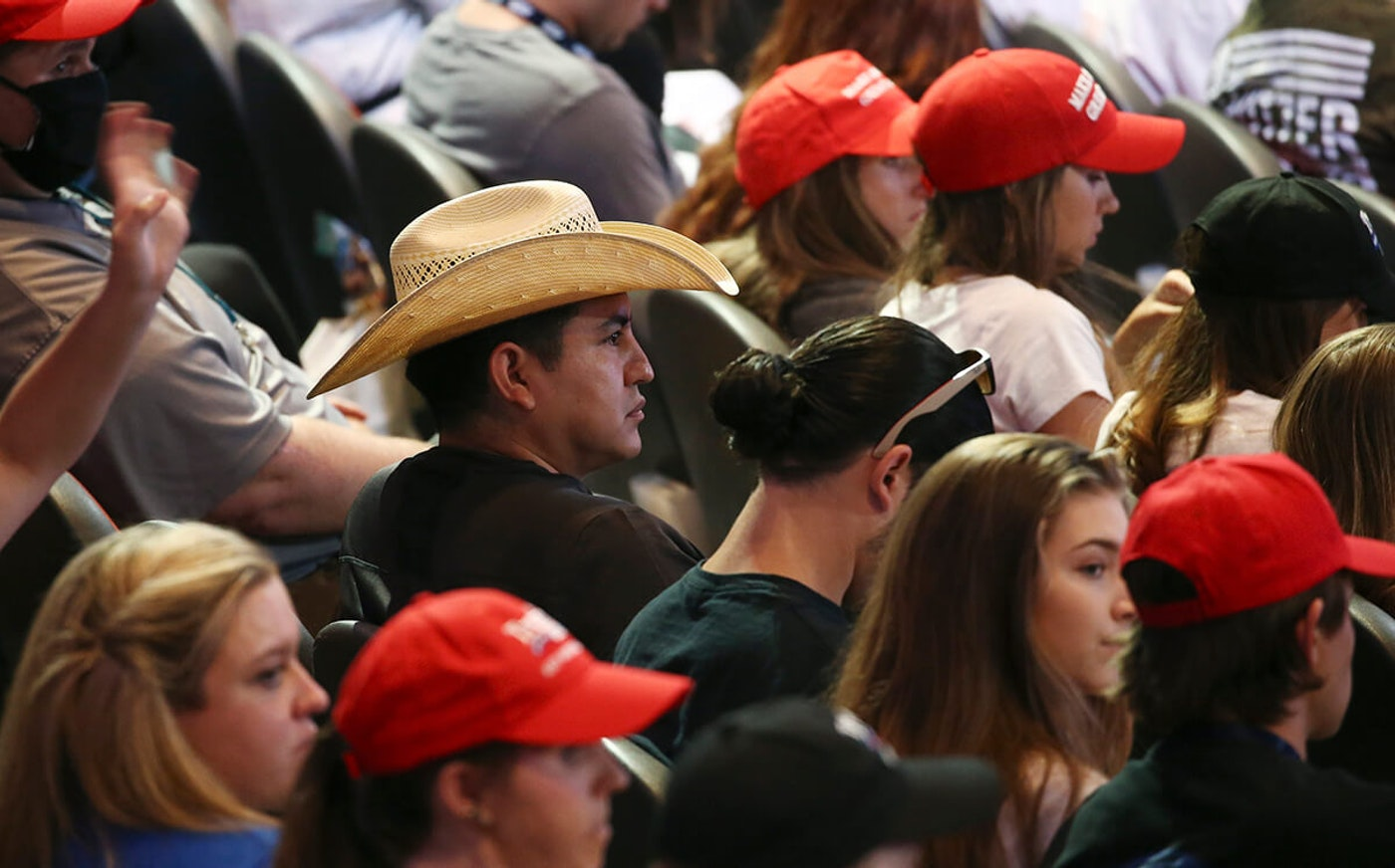 crowd at Trump rally in Phoenix showing only one person wearing a mask
