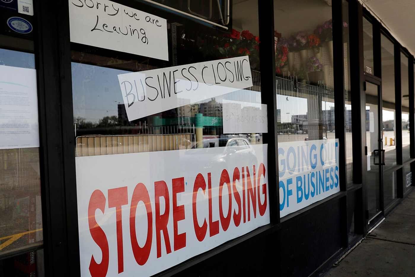 """storefront with """"store closing"""" signs"""