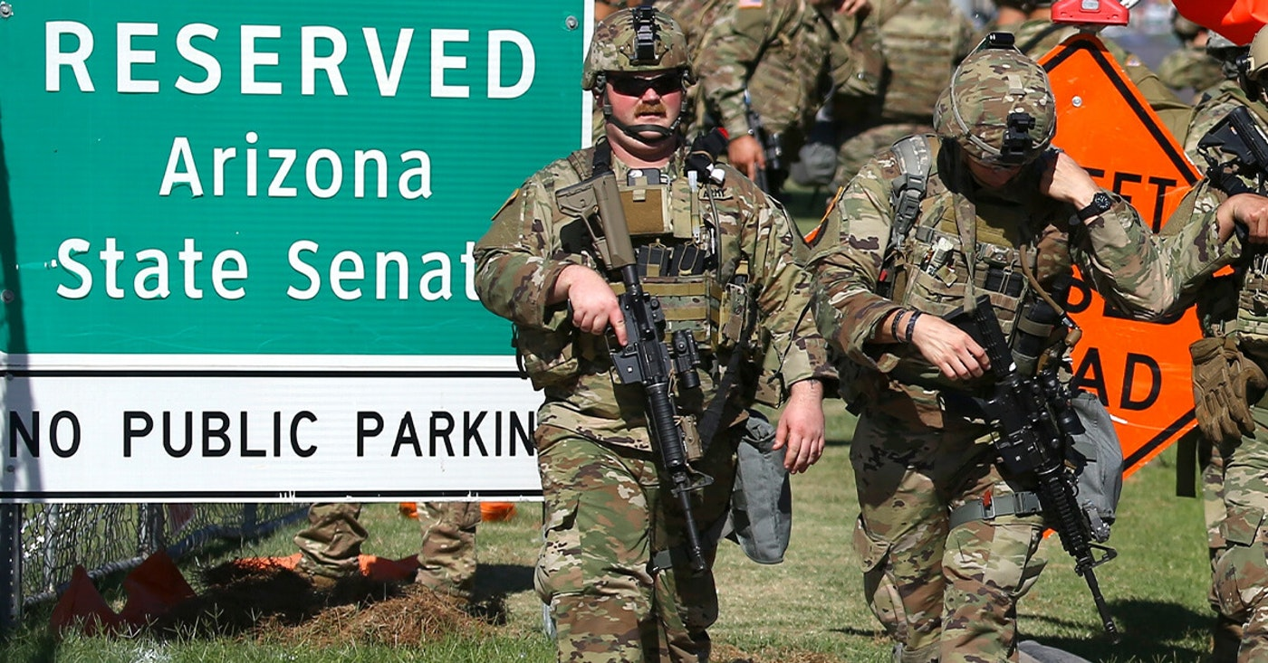 Arizona National Guardsmen disembark from military vehicles near the Arizona Capitol on Tuesday, June 2, 2020, in Phoenix, where there have been several days of protests over the death of George Floyd, who died May 25 after being restrained by Minneapolis police.