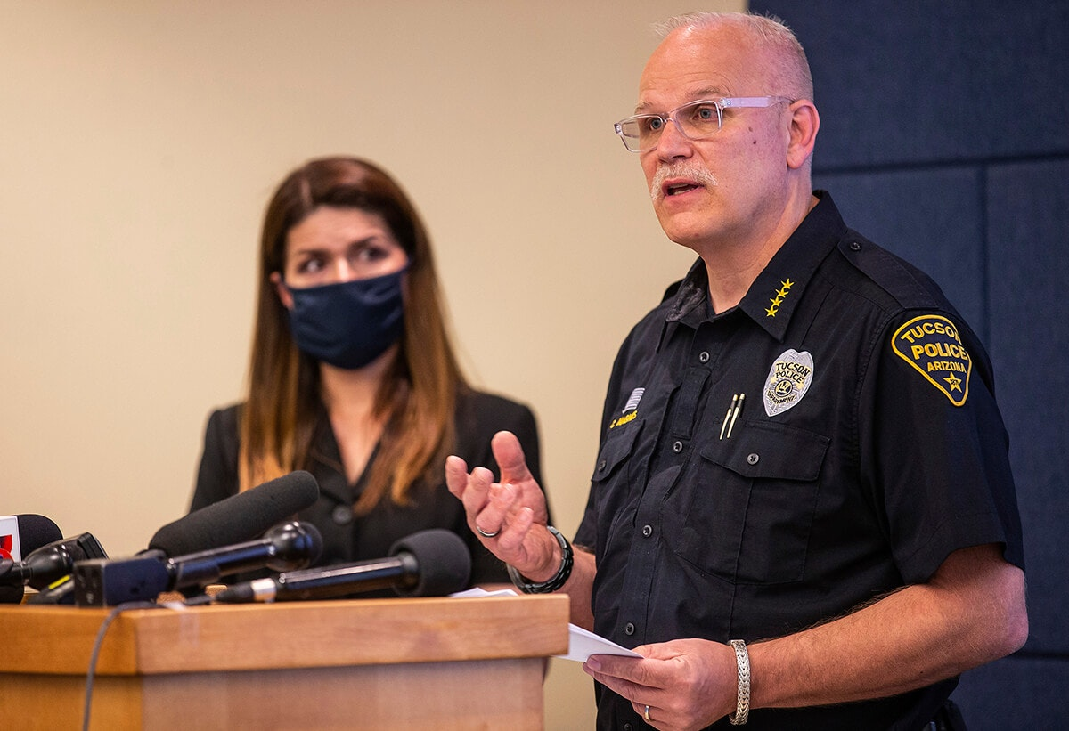 Tucson mayor standing next to police chief as he speaks at podium
