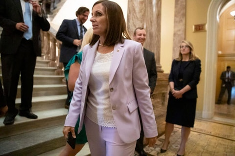 Sen. Martha McSally, R-Ariz., joins her staff after delivering her first major speech on the Senate floor, at the Capitol in Washington, Tuesday, July 30, 2019. McSally is a former Air Force colonel who flew combat missions in Iraq and Kuwait. (AP Photo/J. Scott Applewhite)