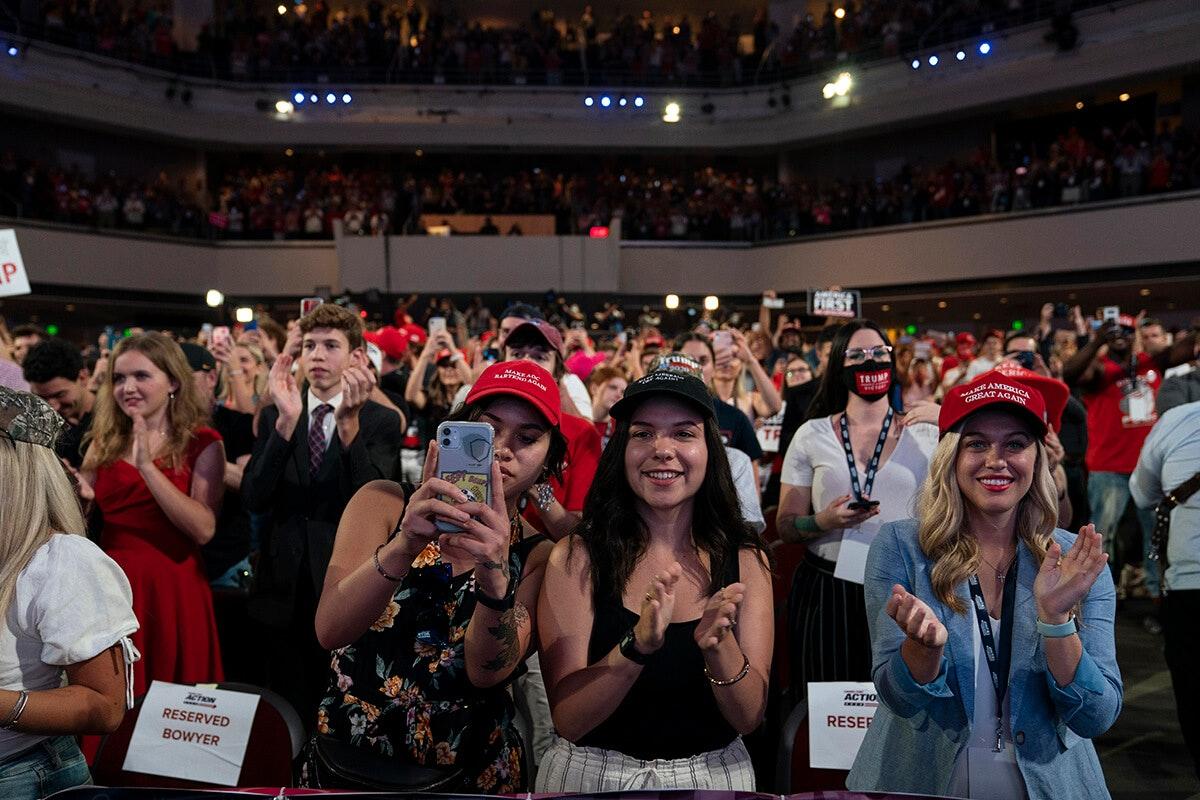 crowd cheering for President Trump inside church auditorium