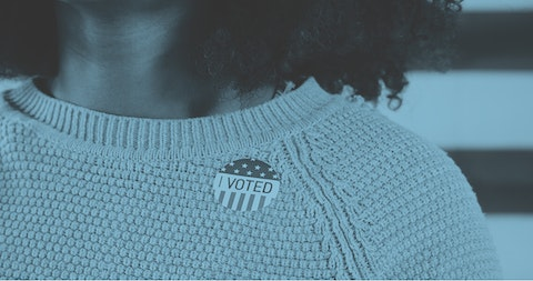woman wearing I Voted sticker