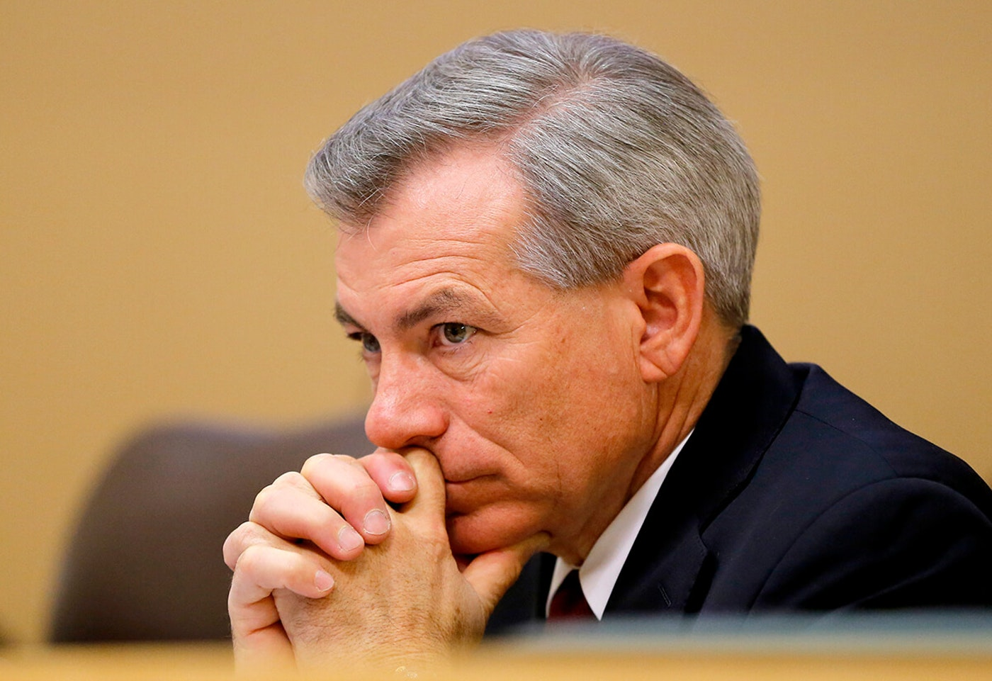 Rep. Schweikert sitting and leaning his chin on his hands