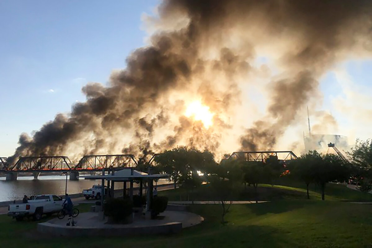 smoke billowing into air above Tempe railroad cars that caught fire