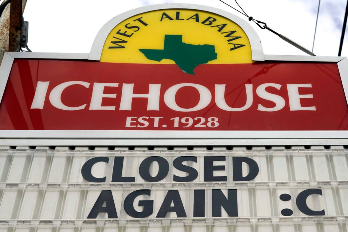 A sign outside the West Alabama Icehouse shows the bar is closed Monday, June 29, 2020, in Houston. Texas Gov. Greg Abbott shut down bars again and scaled back restaurant dining on Friday as cases climbed to record levels after the state embarked on one of America's fastest reopenings. (AP Photo/David J. Phillip)