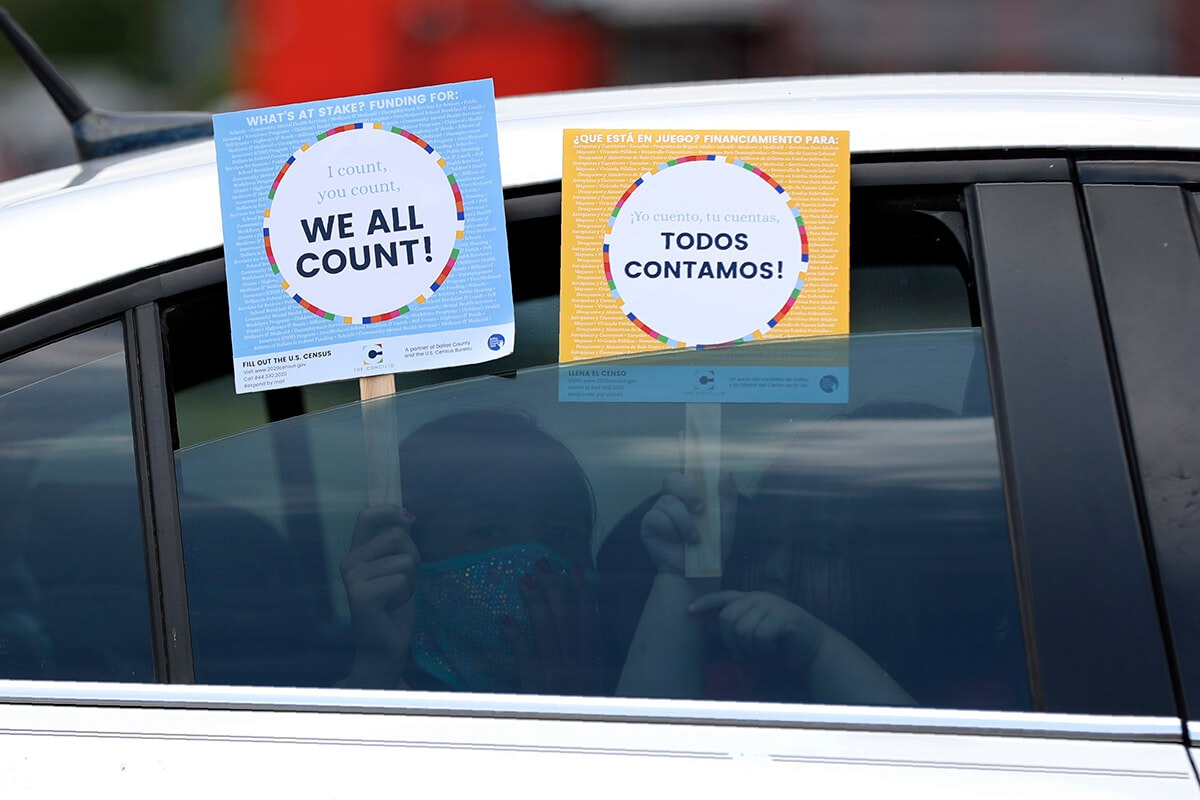 """children holding signs in car saying """"we all count"""""""