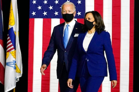 Semocratic presidential candidate former Vice President Joe Biden and his running mate Sen. Kamala Harris, D-Calif., arrive to speak at a news conference at Alexis Dupont High School in Wilmington, Del. (AP Photo/Carolyn Kaster)
