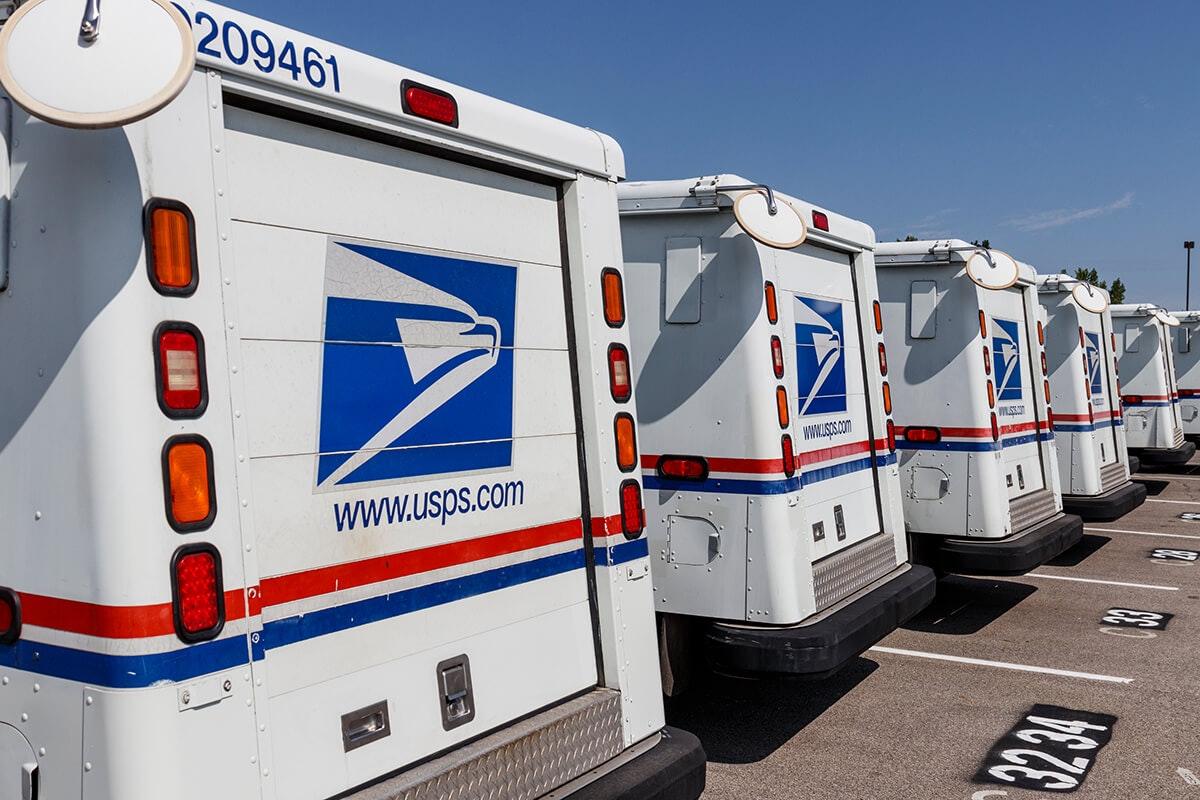 line of USPS mail trucks