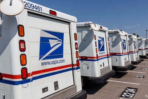 line of USPS mail trucks