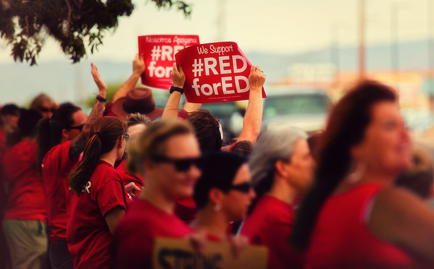 women holding Red for Ed signs at protest