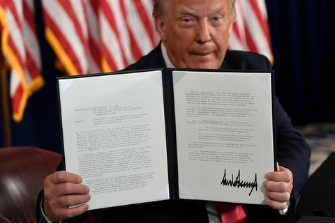 President Trump holding up his executive order