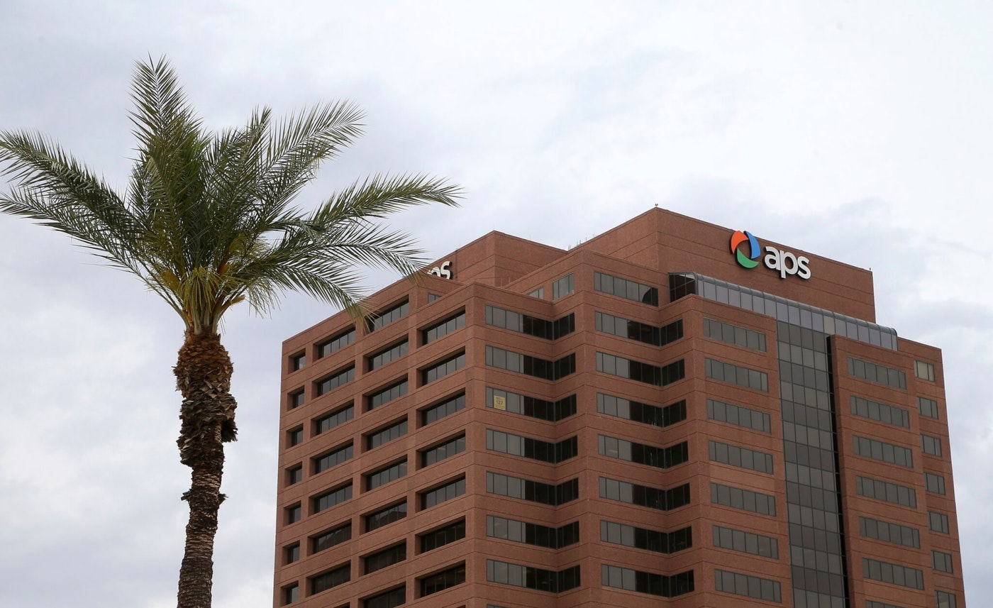 FILE - This Tuesday, April 16, 2019 file photo shows a view of the Arizona Public Service utility company in Phoenix. The new head of Arizona's largest electric utility has apologized for a faulty bill calculator that was supposed to help customers find the cheapest rate plan but instead steered 10,000 of them to higher-priced options. (AP Photo/Ross D. Franklin,File)