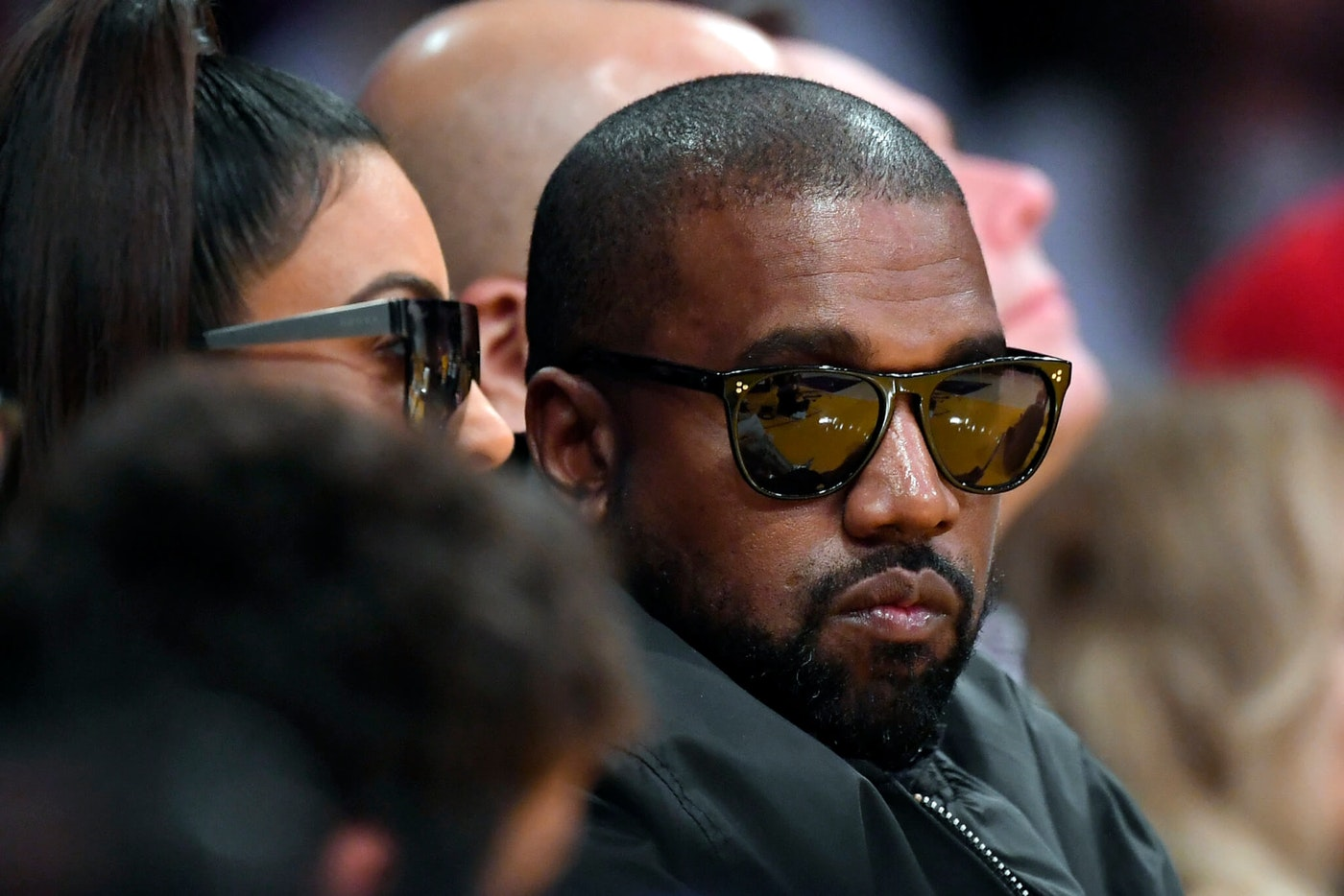 Kim Kardashian, left, and rapper Kanye West watch during the second half of an NBA basketball game between the Los Angeles Lakers and the Cleveland Cavaliers, Monday, Jan. 13, 2020, in Los Angeles. The Lakers won 128-99. (AP Photo/Mark J. Terrill)