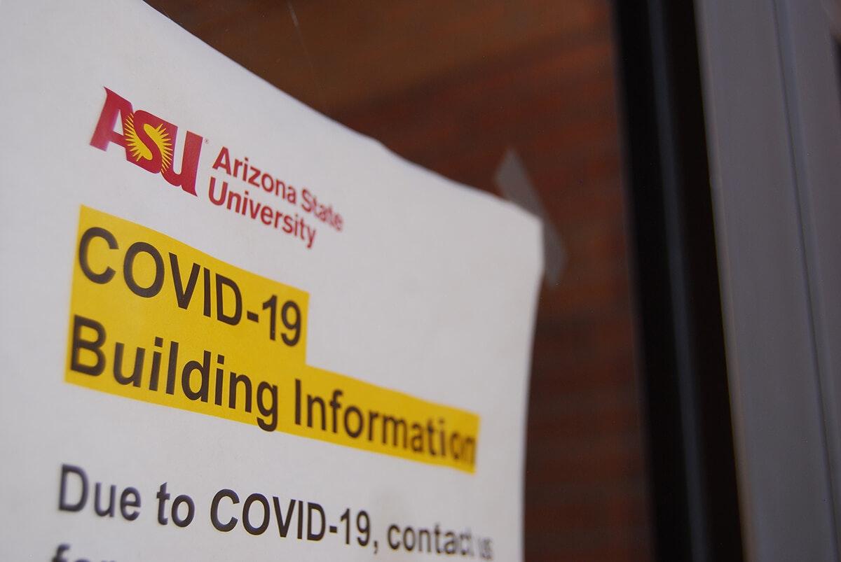 sign on door saying ASU COVID-19 building information