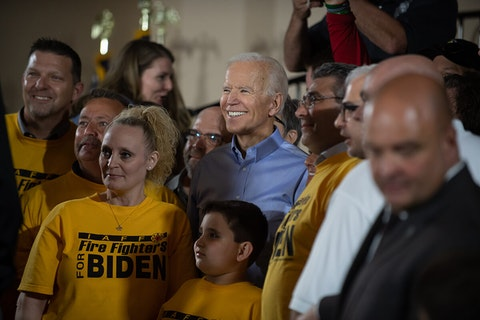Joe Biden posing for photo with supporters at a rally