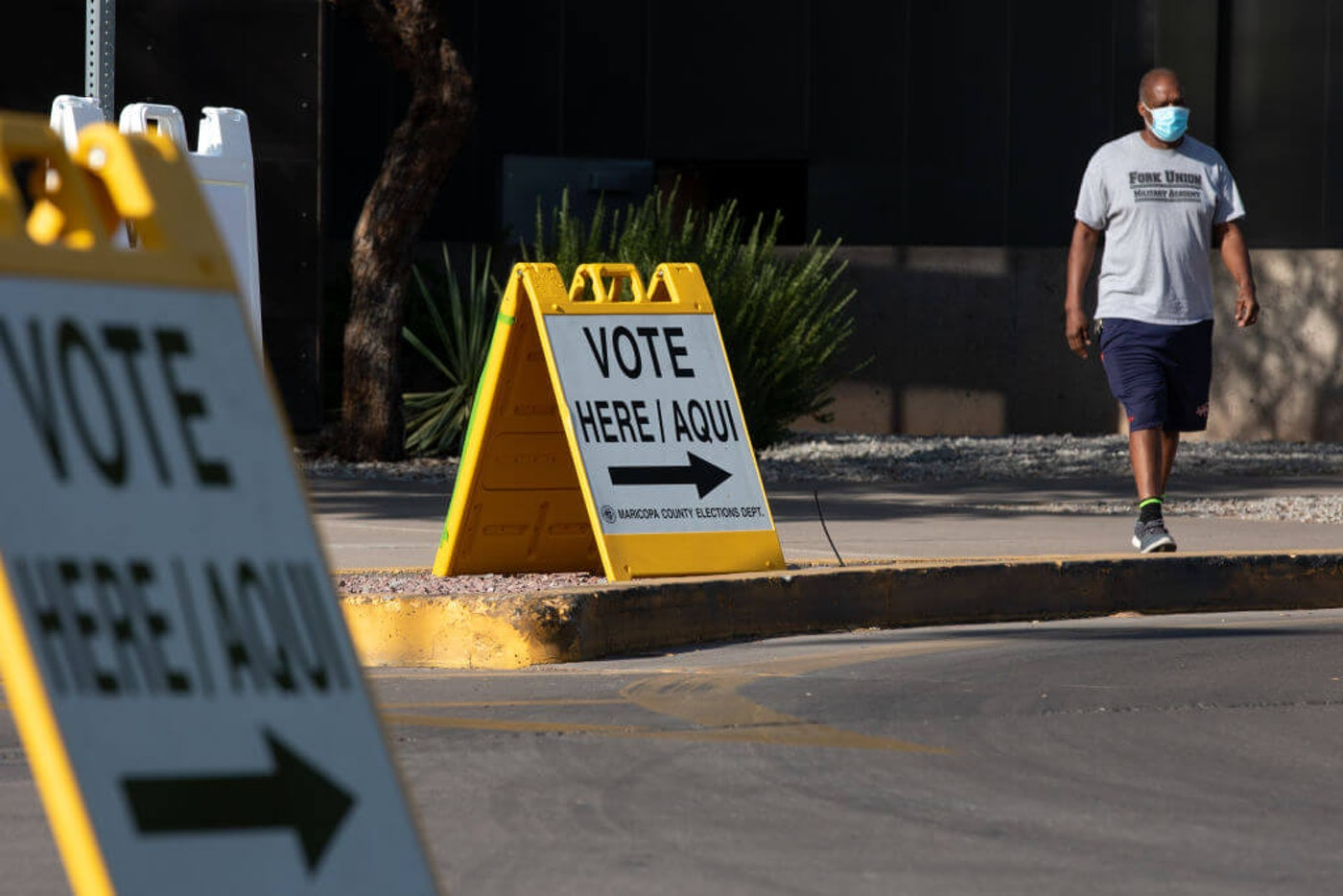 PHOENIX, AZ - AUGUST 04: Kevin Miller exits after voting during Arizona's primary election at Burton Barr Central Library on August 4, 2020 in Phoenix, Arizona. Larger venues have been catered to allow for social distancing as adjustments are made in light of the coronavirus pandemic. (Photo by Courtney Pedroza/Getty Images)