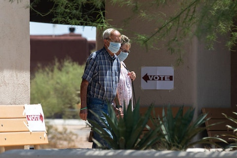 PHOENIX, AZ - AUGUST 04: Paul and Dottie Hoffman exit after casting their vote during Arizona's primary election at Phoenix Laestadian Lutheran Church on August 4, 2020 in Cave Creek, Arizona. Larger venues have been catered to allow for social distancing as adjustments are made in light of the coronavirus pandemic. (Photo by Courtney Pedroza/Getty Images)