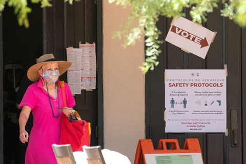 PHOENIX, AZ - AUGUST 04: April Halstead exits after voting during Arizona's primary election at Scottsdale McCormick Ranch on August 4, 2020 in Scottsdale, Arizona. Larger venues have been catered to allow for social distancing as adjustments are made in light of the coronavirus pandemic. (Photo by Courtney Pedroza/Getty Images)