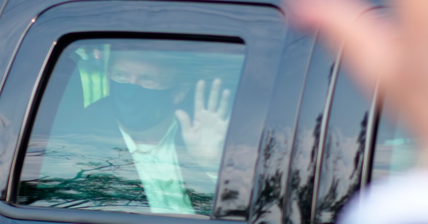 President Donald Trump drives past supporters gathered outside Walter Reed National Military Medical Center in Bethesda, Md., Sunday, Oct. 4, 2020. Trump was admitted to the hospital after contracting COVID-19. (AP Photo/Anthony Peltier)