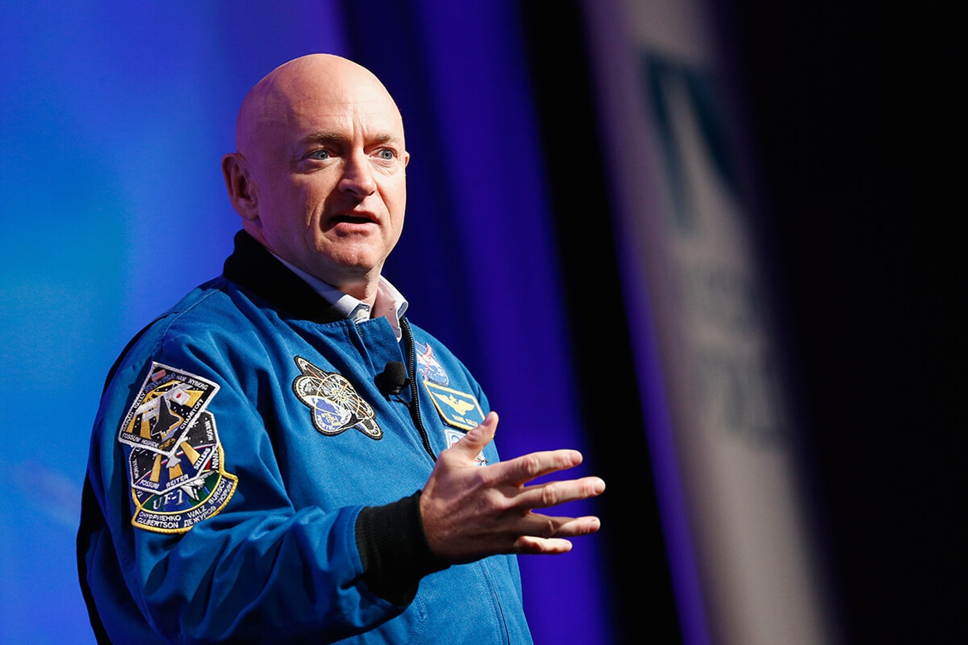 Mark Kelly speaking on a stage
