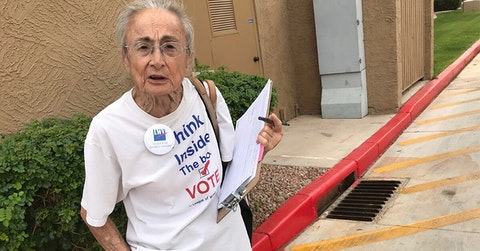 FILE - In this April 19, 2018, file photo, Rivko Knox, of Phoenix, a volunteer with the League of Women Voters, collects signatures for a ballot measure on campaign financing outside a polling station in Glendale, Ariz. A lawsuit filed Tuesday, July 3, 2018, on Knox's behalf, seeks to overturn a 2016 law that bars groups in Arizona from collecting early mail-in ballots from voters and delivering them as part of get-out-the-vote efforts. Photo by Anita Snow, Associated Press
