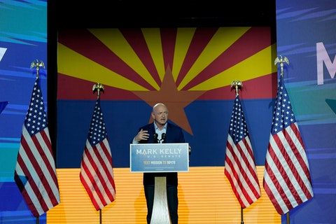 Sen.-elect Mark Kely gestures as he speaks during an election night event Tuesday, Nov. 3, 2020 in Tucson, Ariz. (AP Photo/Ross D. Franklin)