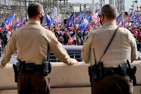 Maricopa County Sheriff's Deputies watch the crowd during a pro Trump rally from the steps of the Maricopa County Recorder's Office.