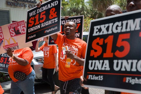 People gather together to ask  the McDonald's corporation to raise workers wages to a $15 minimum wage as well as demanding the right to a union on May 23, 2019 in Fort Lauderdale, Florida.  The nation wide protest at McDonald's was held on the day of the company's shareholder meeting. (Photo by Joe Raedle/Getty Images)