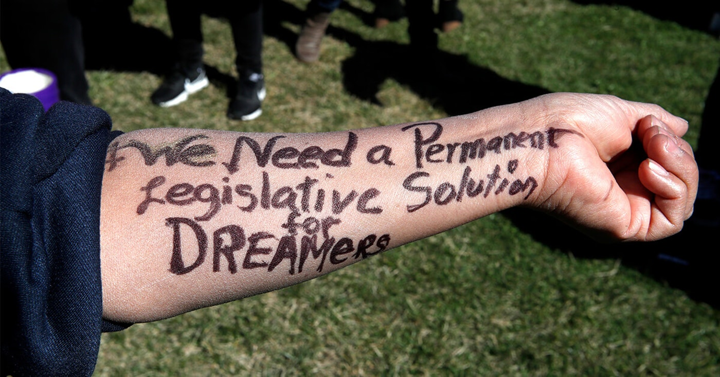 """Ivon Meneses, of Las Vegas, had written """"we need a permanent legislative solution for Dreamers,"""" on her arm as she and other supporters of the Deferred Action for Childhood Arrivals (DACA) program, attended an action in support of DACA recipients. (AP Photo/Jacquelyn Martin)"""