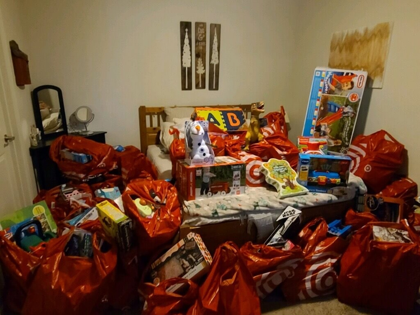 Small room filled with bags of gift donations