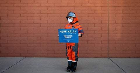 Julian Rosales poses for a portrait dressed as then-candidate Mark Kelly for Halloween on the last day of early voting at Fowler Elementary Early Voting Center in Phoenix, Arizona. Kelly went on to win his bid for US Senate, and was sworn in on Dec. 2, 2020.