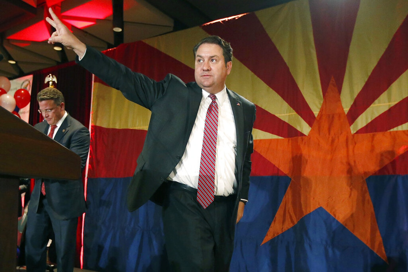 FILE - In this Nov. 4, 2014, file photo, Arizona Republican Attorney General Mark Brnovich waves to supporters at the Republican election night party in Phoenix. Brnovich said Friday, July 26, 2019, that Arizona is poised to resume executions after a five-year hiatus brought on by an execution that critics said was botched, a subsequent lawsuit challenging the way the state carries out the death penalty, and the difficulty of finding lethal injection drugs. (AP Photo/Ross D. Franklin, File)