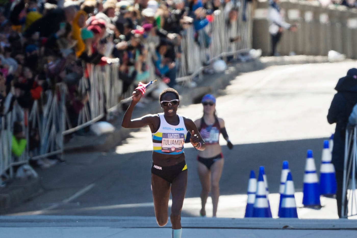 FILE - In this Feb. 29, 2020, file photo, first place finisher Aliphine Tuliamuk leads second place finisher Molly Seidel to the finish in the U.S. Olympic marathon trials in Atlanta. Tuliamuk will have company in Tokyo with her baby, Zoe, allowed to travel with her. The original plan was to start a family after the Tokyo Olympics. But when the Summer Games were postponed by the pandemic, the 32-year-old Tuliamuk and her fiance, Tim Gannon, decided not to wait. (AP Photo/John Amis, File)