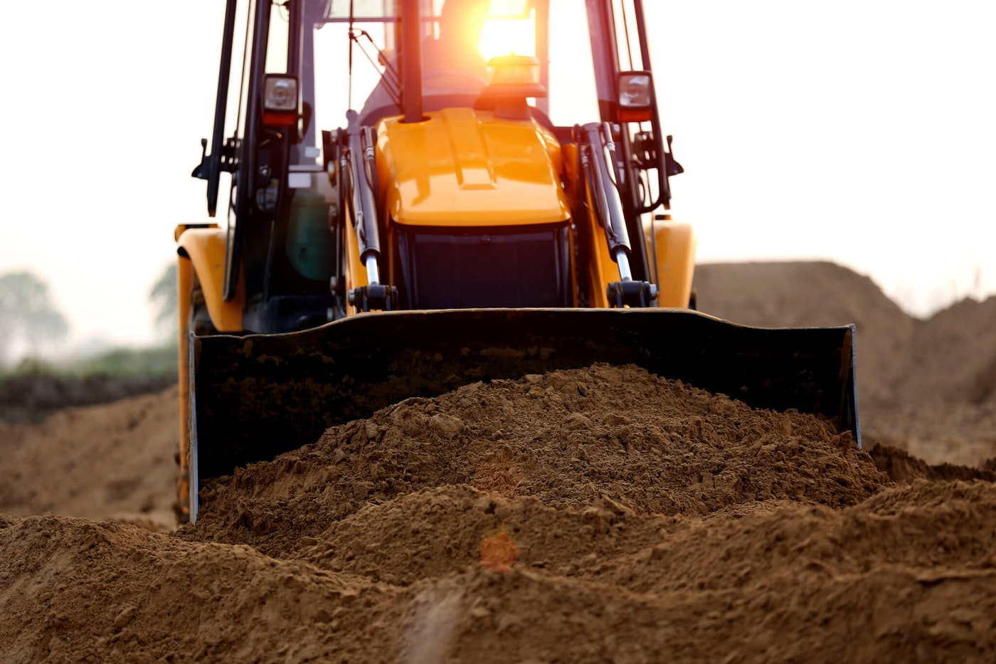 close-up of a heavy machine scooping dirt