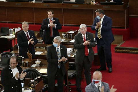 In this April file photo, NC lawmaker David Lewis (standing, far right) at work in the NC General Assembly. Lewis abruptly resigned Thursday as federal prosecutors revealed he was accepting a plea deal on felony charges. (AP Photo/Gerry Broome)