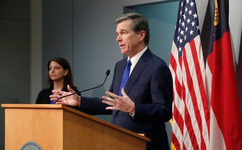 Gov. Roy Cooper, at the podium, and NC DHHS Secretary Mandy Cohen. (Photo by Dept. of Public Safety)