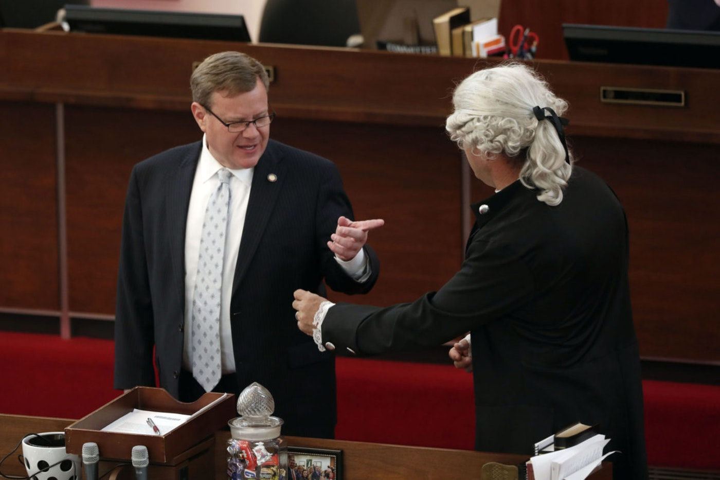 House Speaker Tim Moore, R-Cleveland, left, speaks with Rep. Michael Speciale, R-Craven, wearing colonial attire, in this April file photo. Lawmakers like Speciale have framed coronavirus as a debate over constitutional liberties. (AP Photo/Gerry Broome)